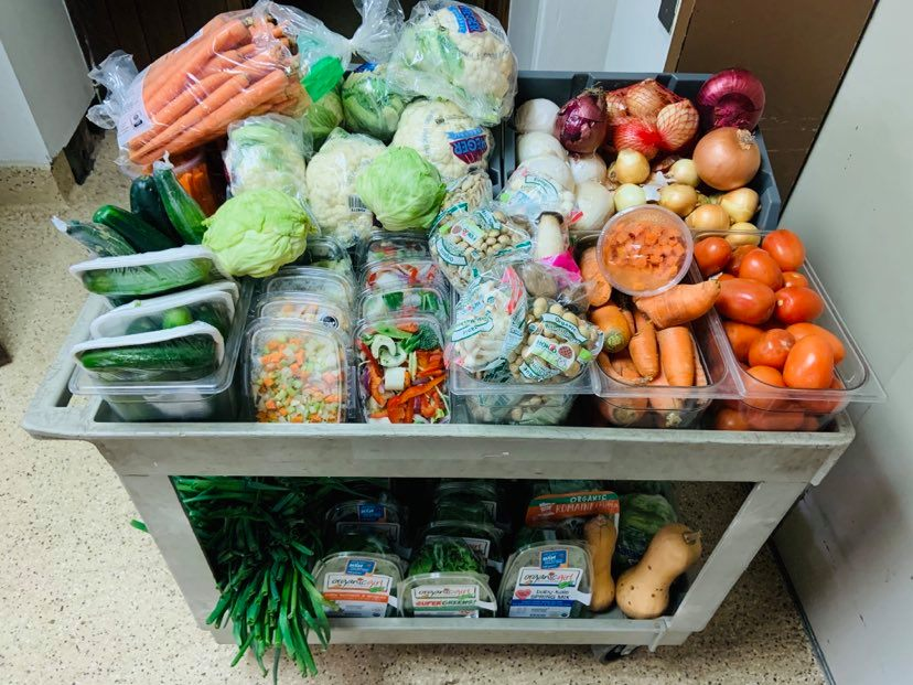 cart overflowing with vegetables